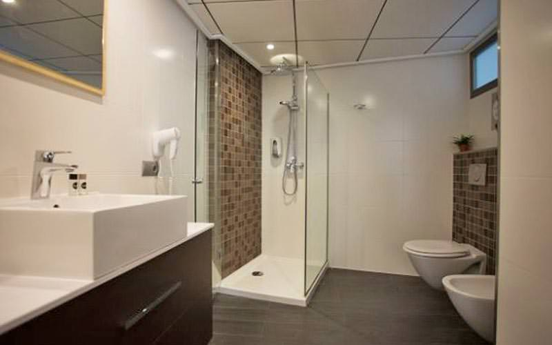 The bathroom area with sink, toilet and shower