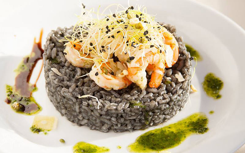 Example plate of food at the Botel Marina - black rice and prawns