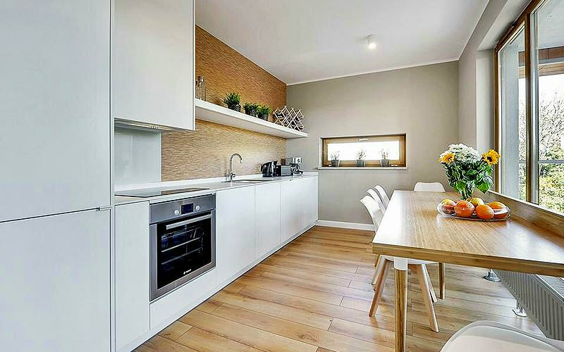 A modern kitchen and dining area at Sun and Snow Apartments