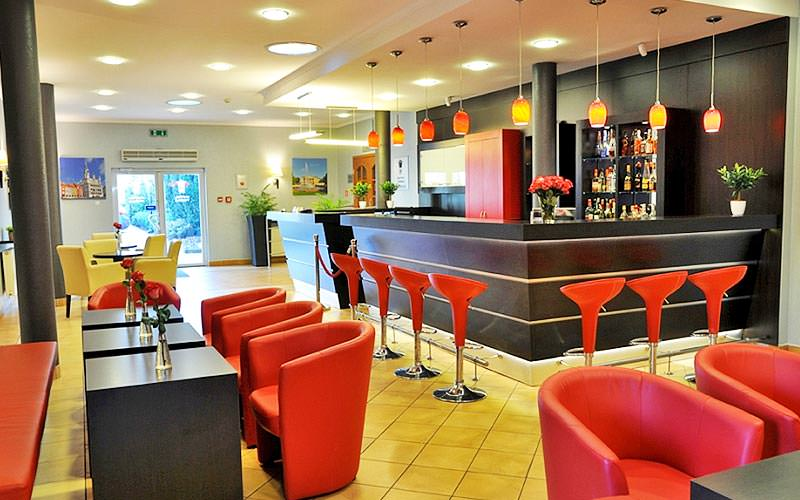 The bar area with red and yellow seating