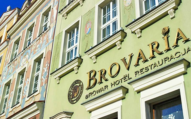 The light green exterior of Brovaria Hotel and restaurant