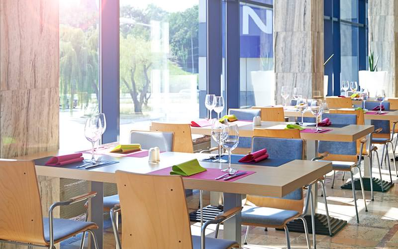 A seating area with tables set for dinner
