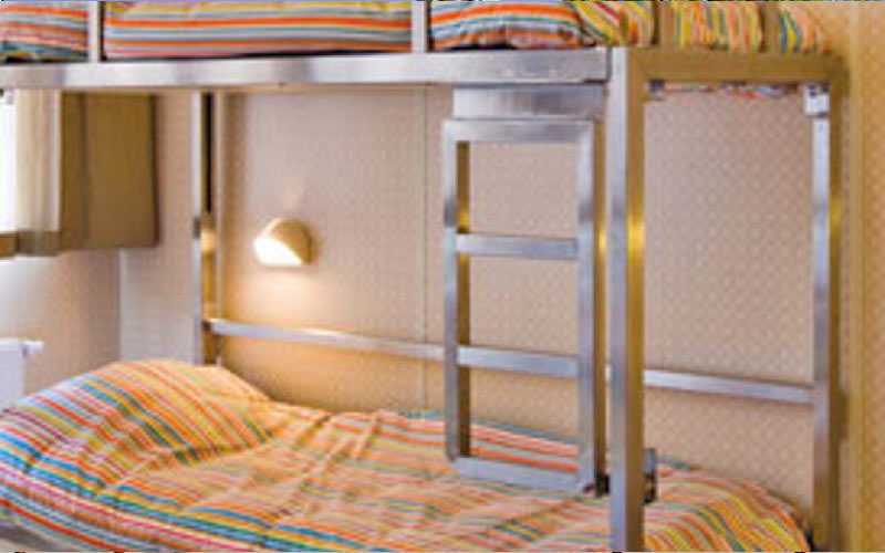 A metal bunk bed in a small room