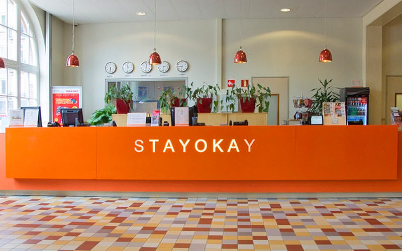 The orange reception desk of Stayokay hotel