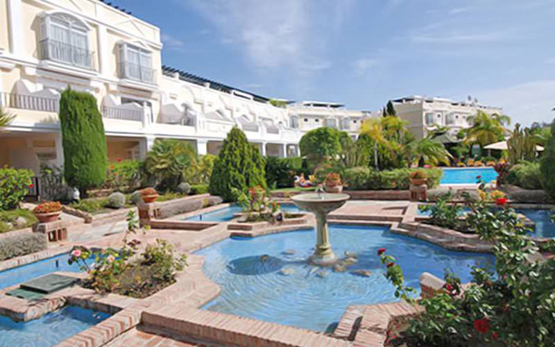 The outdoor fountains and gardens, in front of the exterior of the Aloha Gardens, Marbella