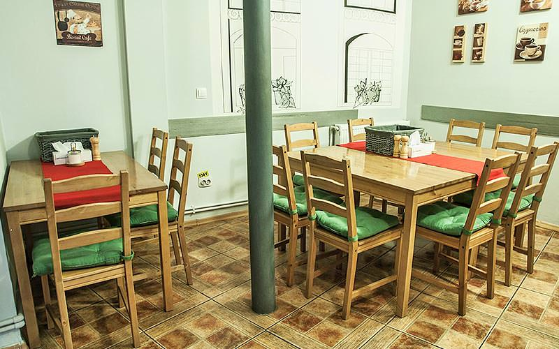 A traditional dining area in Antique Hostel