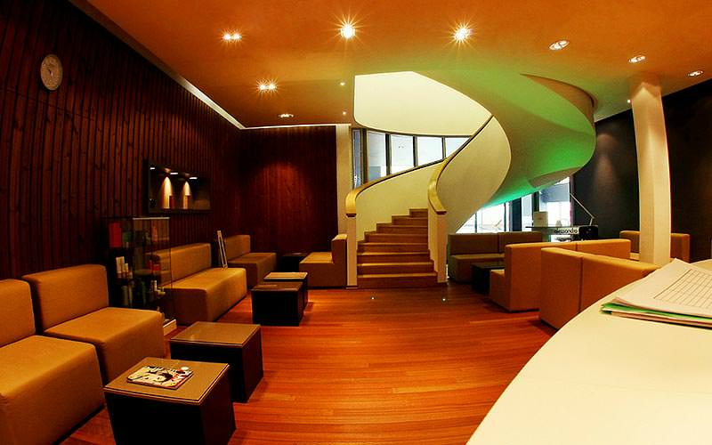 A lounge seating area and spiral staircase at Hotel Westin