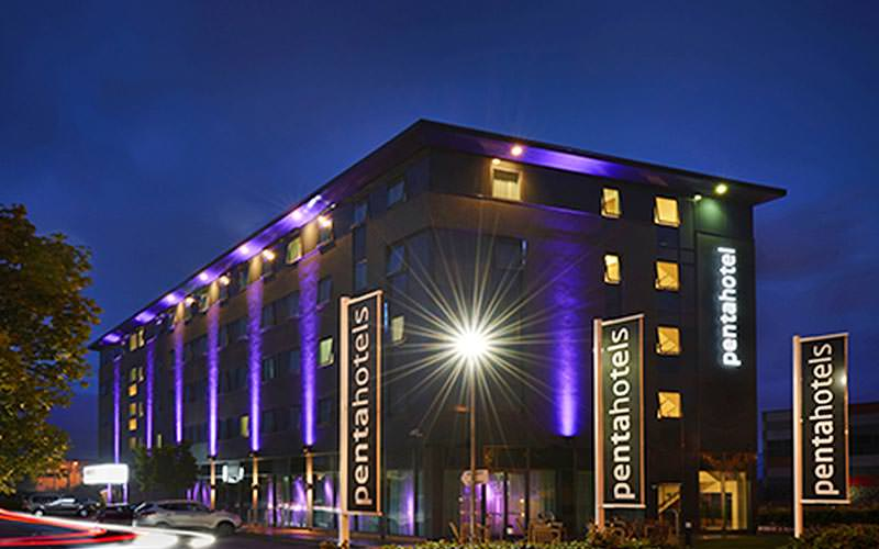 The exterior of Pentahotels at night time