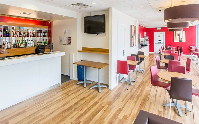 The dining room area and bar within the Travelodge