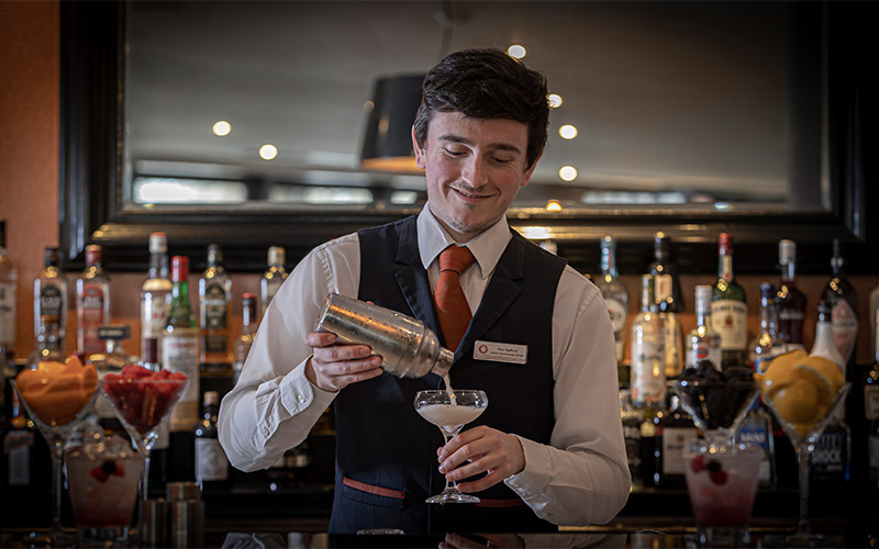 An indoor swimming pool in a blue and green room