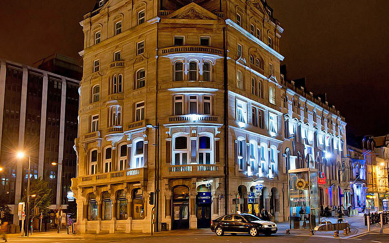 Outdoor building exterior of the Royal Hotel at night