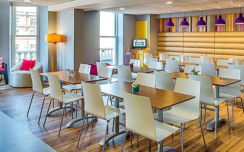 Tables and chairs in the Ibis Styles, Blackpool, hotel restaurant