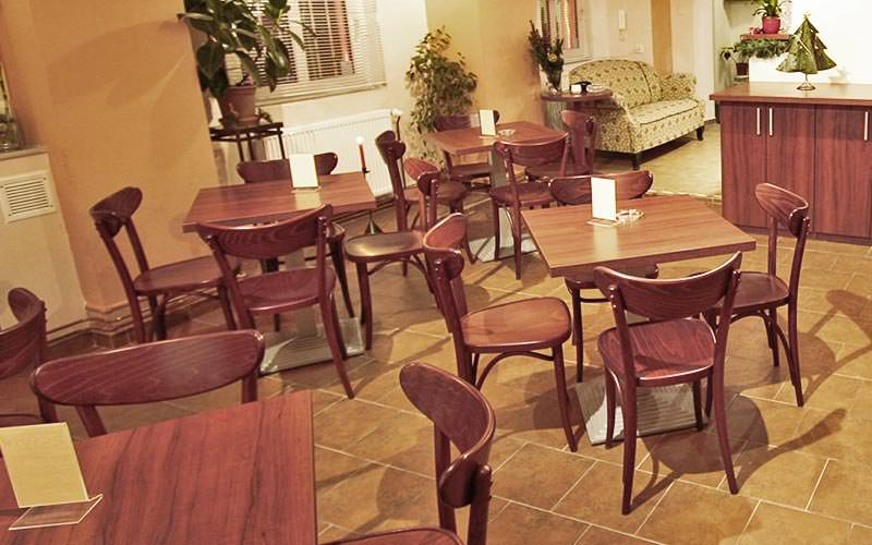 Chairs and tables set up in a traditional bar area