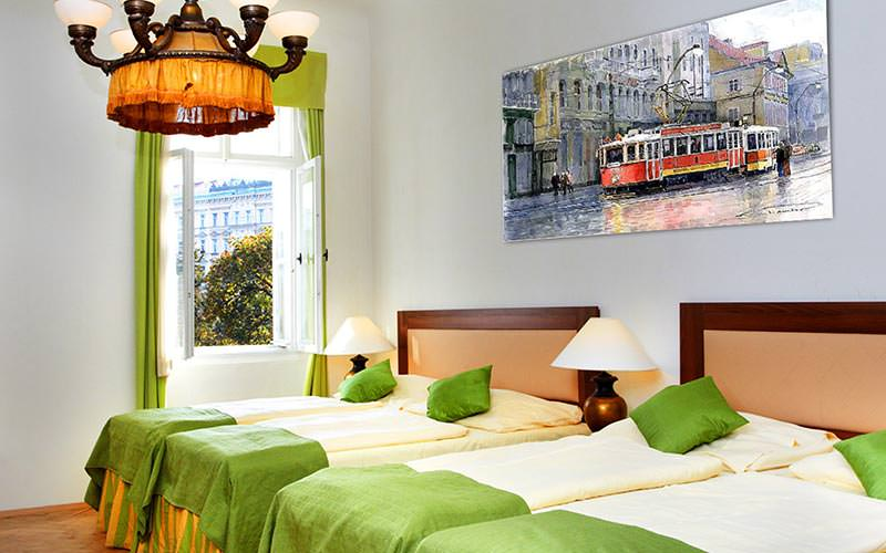 Four single beds in a room with a painting of a tram up on the wall behind them