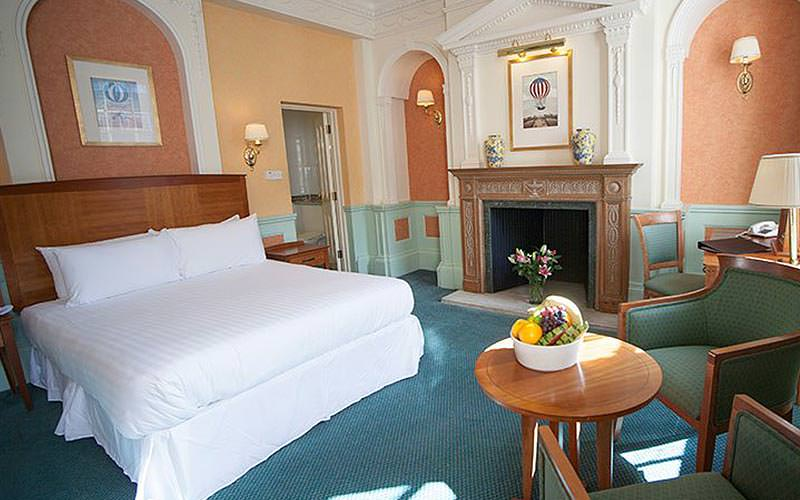 A double room with ornate fireplace in the room