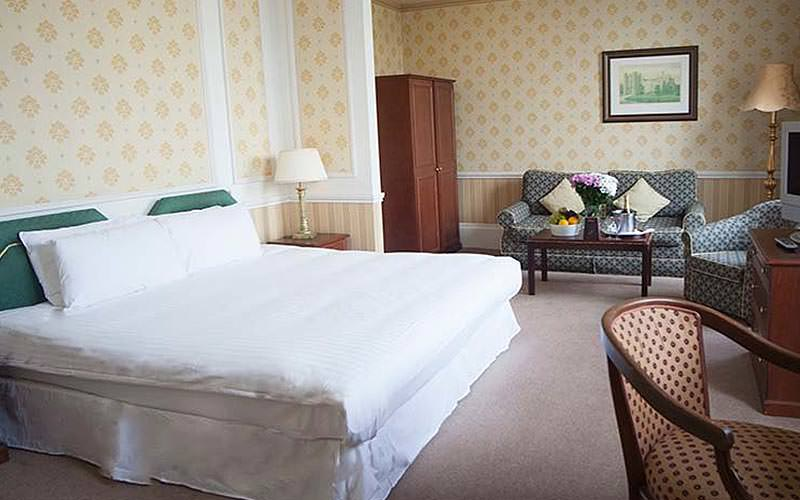 A double room with traditional decor and furnishings