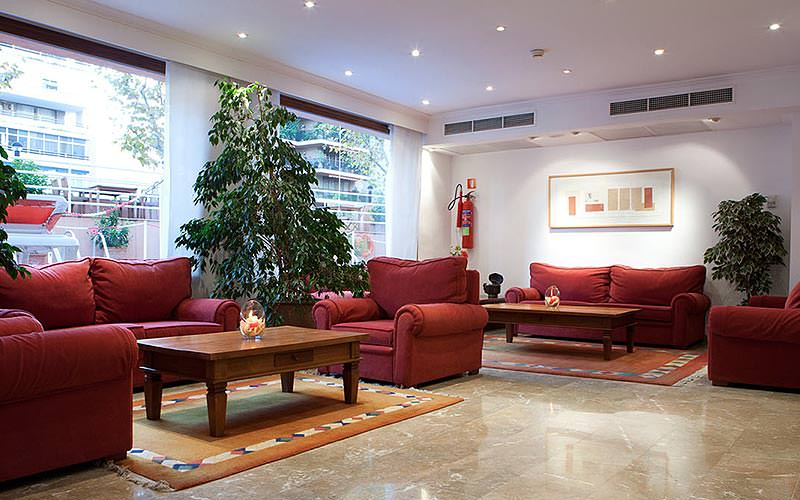 Red sofas and chairs around coffee tables