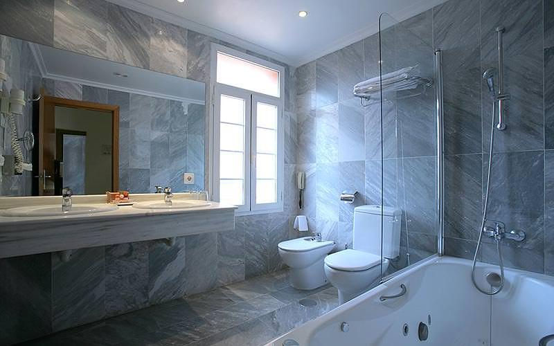 A grey tiled bathroom