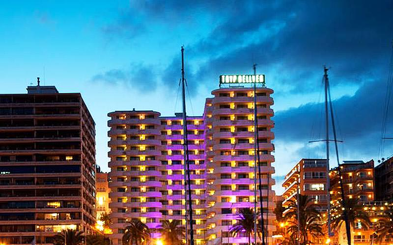 Hotel Melia TRYP Bellver illuminated at dusk by coloured lighting