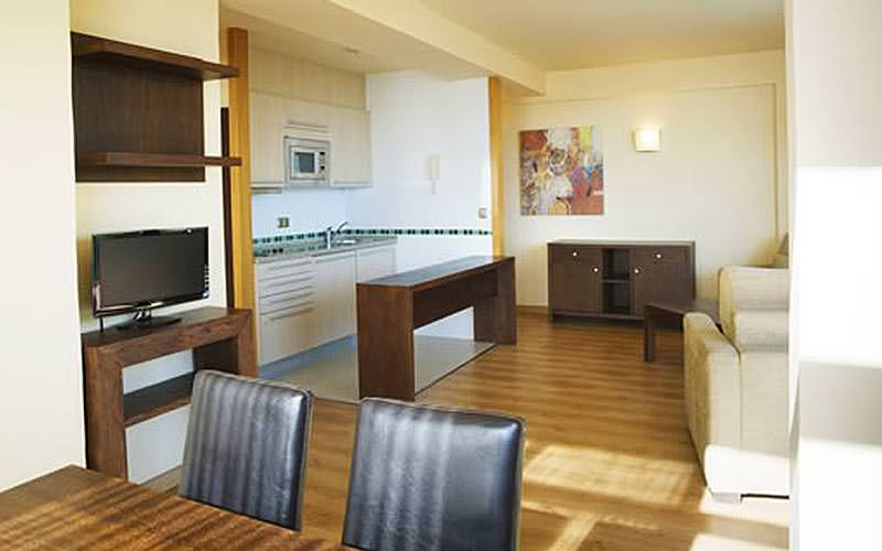 A kitchenette and dining area of an MS Alay Apartments apartment