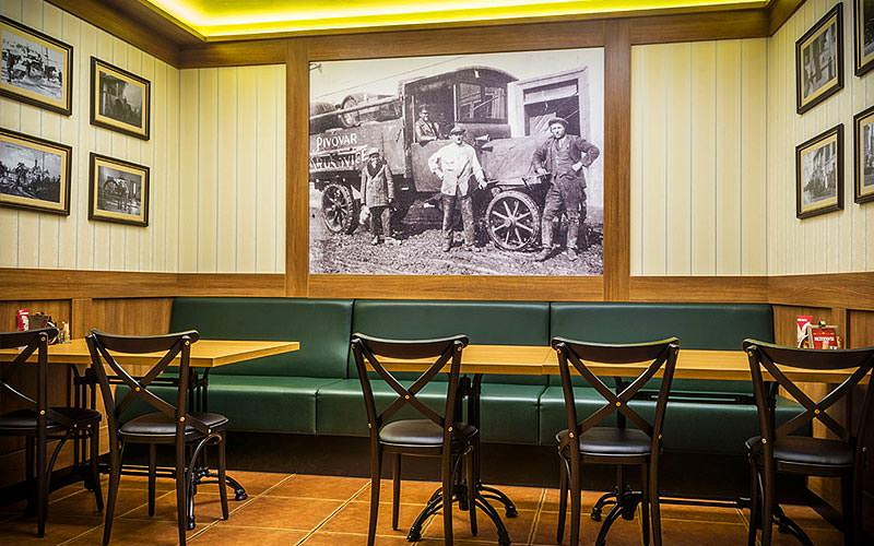 The interiors of a seating area with old fashioned photographs on the wall