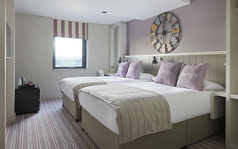 A guest bedroom at Village Hotel Edinburgh