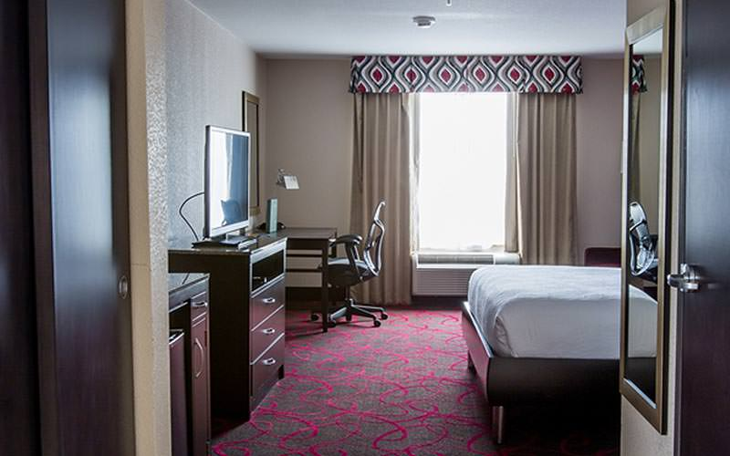 A guest room with bed, desk and TV at the Hilton Garden Inn Dublin