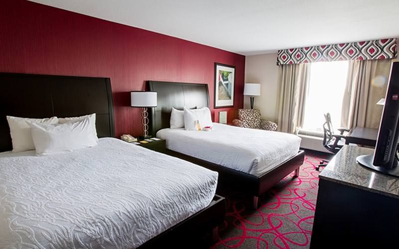 A guest room with two double beds at the Hilton Garden Inn Dublin