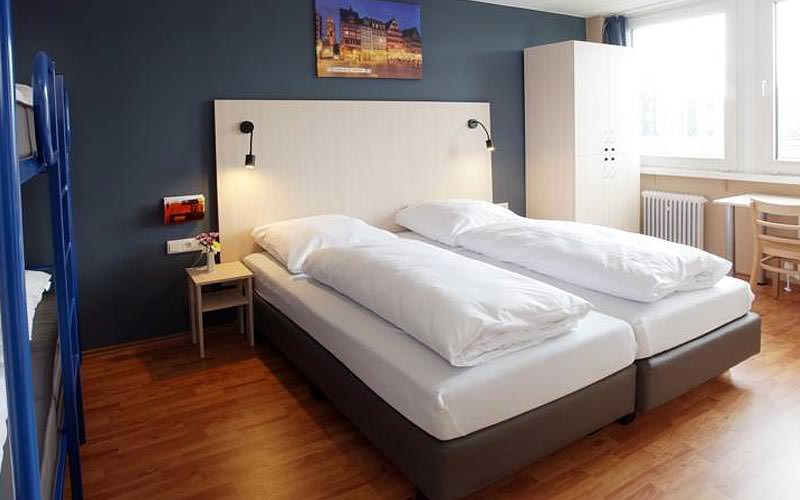 Two twin beds in a guest room at A&O Stuttgart City hostel