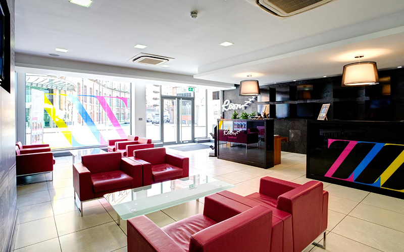 The reception area of Roomzzz Leeds City Apartments