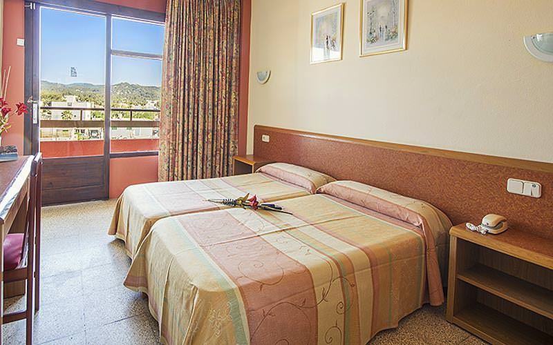 Guest bedroom with balcony at Azuline S´Anfora & Fleming Hotel