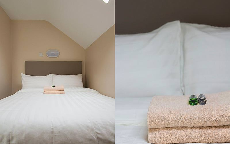 A split image of a double bed with towels on and a close up of the towels