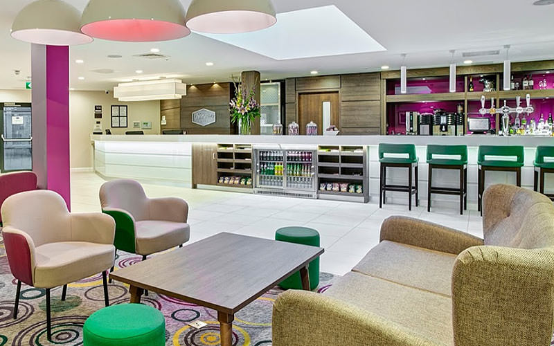 The bar and lobby area of Hampton by Hilton