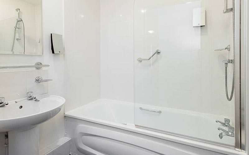 White bath and sink in a bathroom