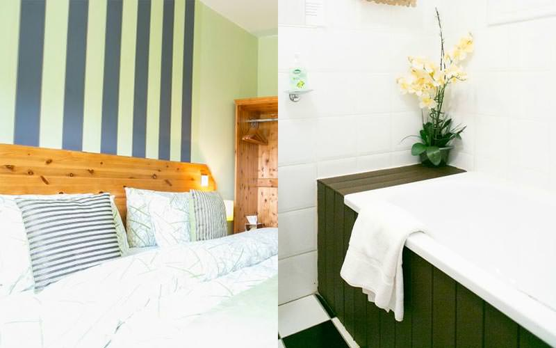 A split image of a bed against a green and black striped wall and a bath