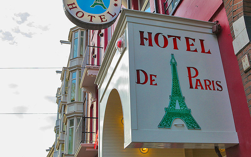 The exterior Hotel de Paris sign, with buildings in the background