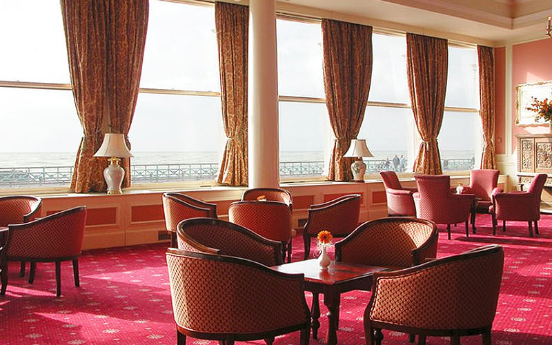 A seating area in The Royal Albion Hotel, overlooking the sea front