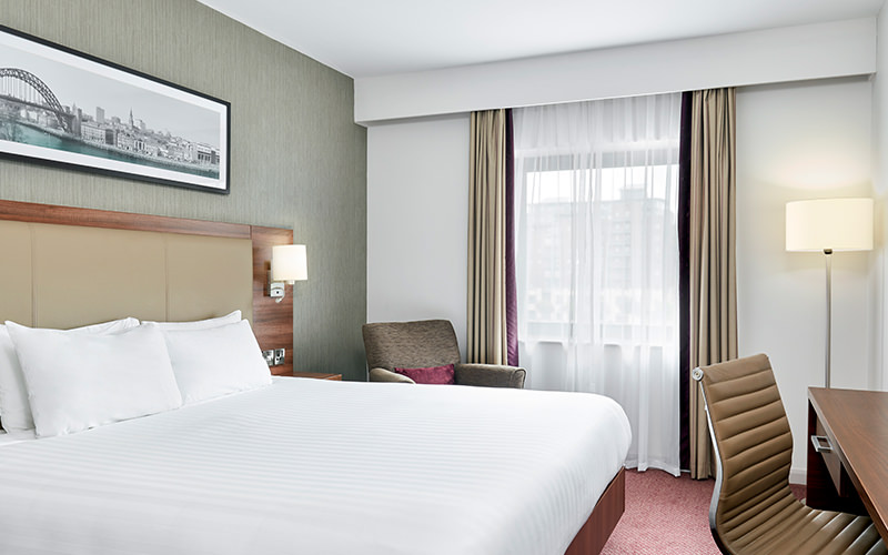 A room with a single bed and a double bed within Jurys Inn Gateshead Quays