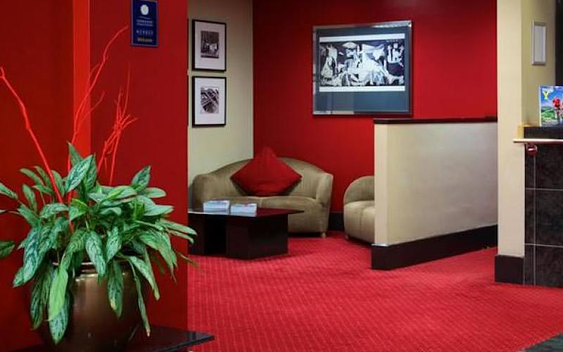 The red colour schemed lobby area of a hotel