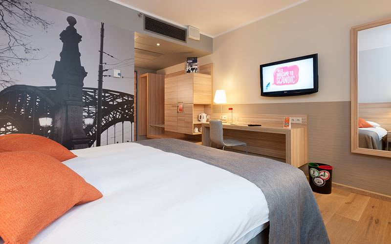 A modern guest room at Scandic Wroclaw