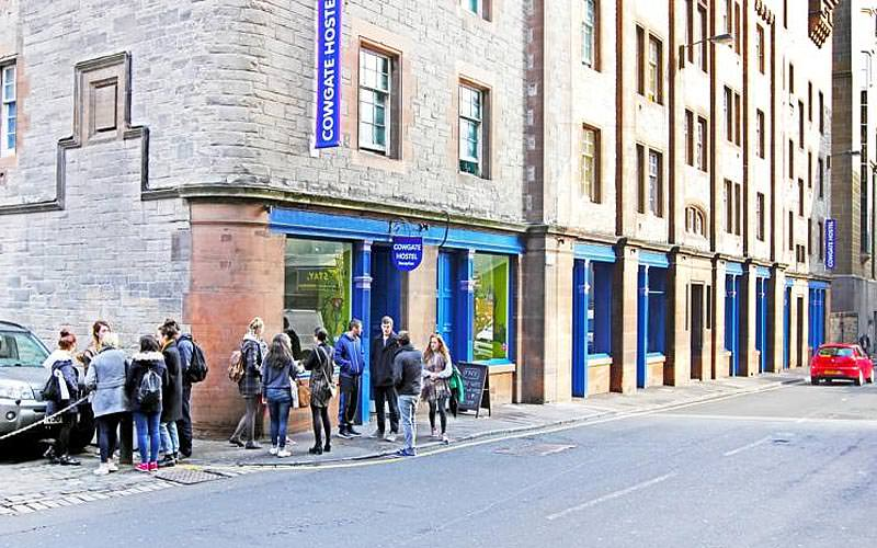 The exterior of Cowgate Hostel with people standing outside