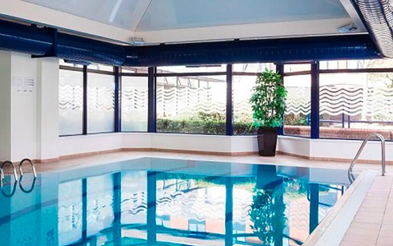 A luxurious swimming pool within Park Inn by Radisson