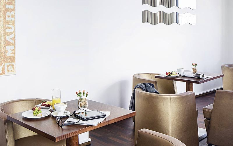 A pair of dining tables at the Austria Trend Hotel