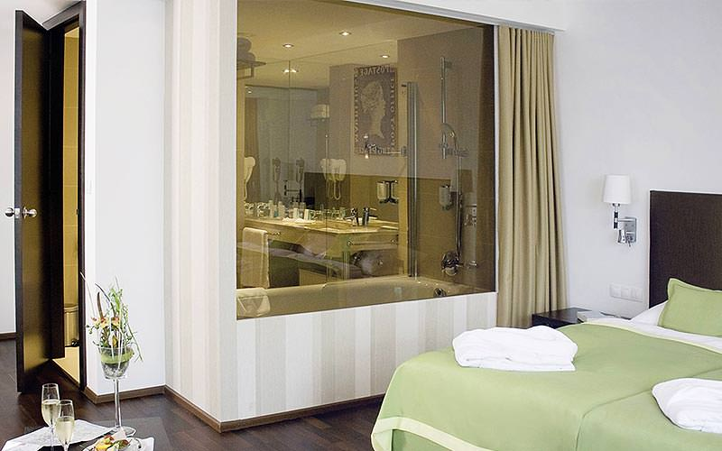 View into the en-suite bathroom of a guest room at the Austria Trend Hotel