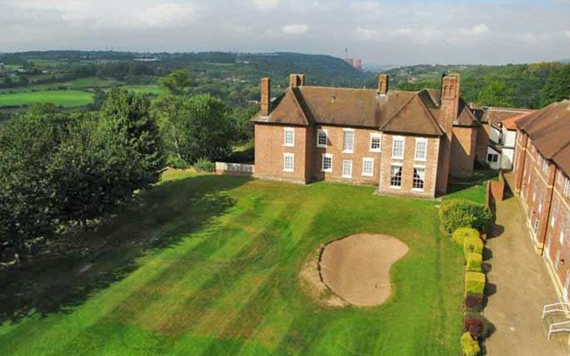 Telford Hotel and Golf Resort from above, showing the surrounding grounds and golf course in front of it