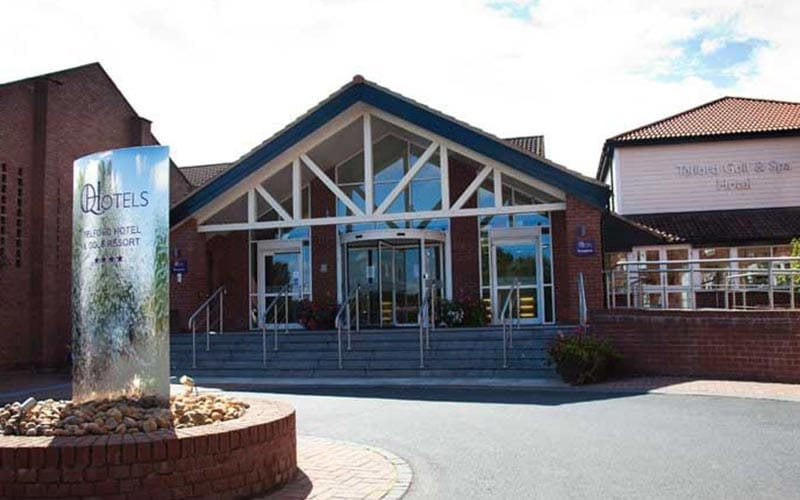 The exterior of Telford Hotel and Golf Resort, with the Q Hotels logo in front