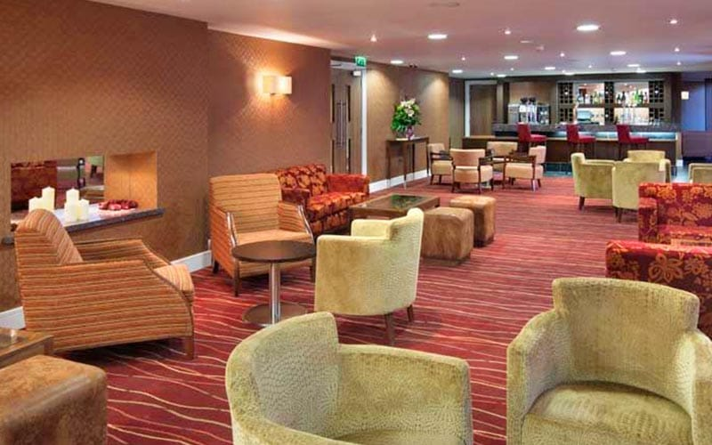 The bar area in Telford Hotel and Golf Resort with a bright red and orange carpet
