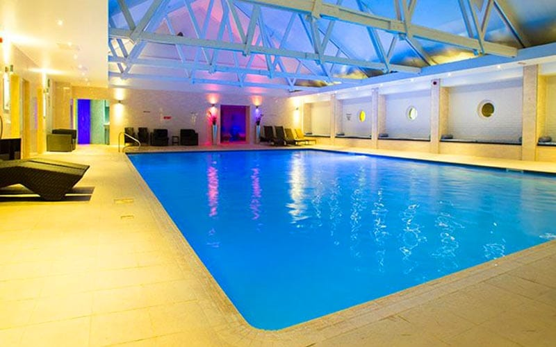A swimming pool area within Telford Hotel and Golf Resort, illuminated by bright lights