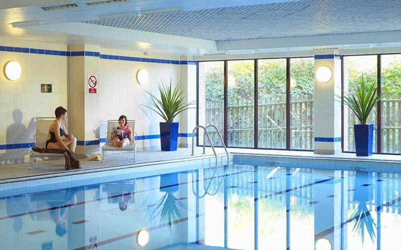 The swimming pool area in The Hampshire Court Hotel