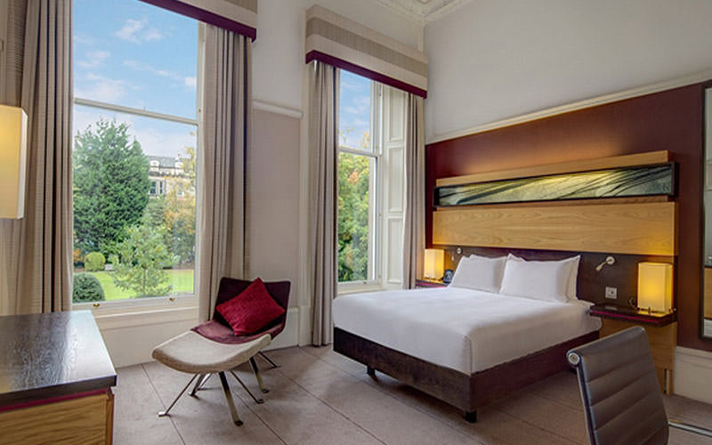 A spacious double room with picturesque gardens outside the window